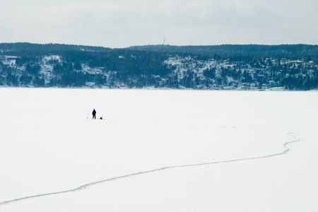 A person Ice fishing on the oslo fjord in early March. Stock Photo - 774582