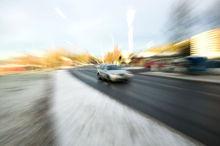 Zoom blur of a speeding car on a urban road Stock Photo - 774536