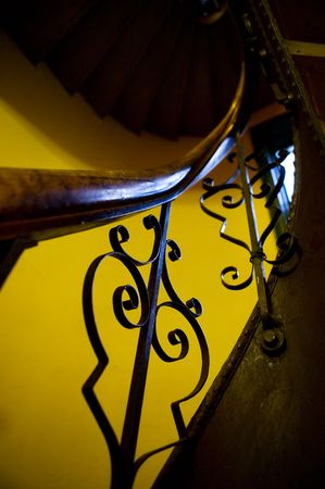 stairwell: An abstract image of an old stairwell and railing with decorative iron. Stock Photo