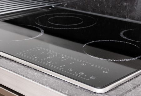 A modern induction stove detail photo