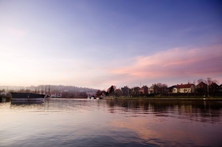 late fall: A boat harbor in the late fall painted in the evening light of sunset Stock Photo
