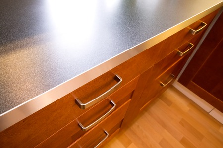 A detail close up image of a stylish kitchen counter and drawer. photo