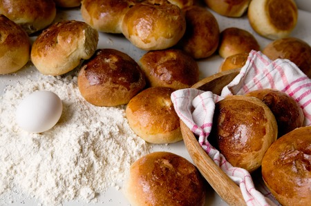 Close up detail of freshly baked hot cross buns in  renaissance lighting. Stock Photo - 1535892