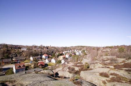 fredrikstad: A street following a valley in a rock countryside.  Fredrikstad Norway.