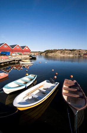 fredrikstad: A group of small row boats tied to the dock  Stock Photo