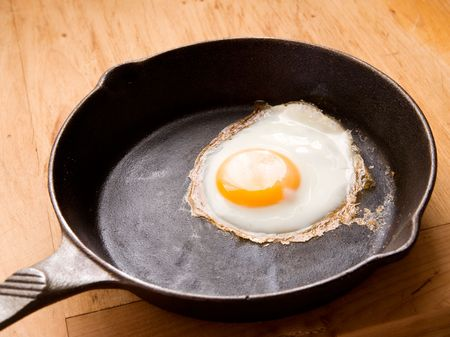 A fried in a cast iron pan. Stock Photo - 1894894