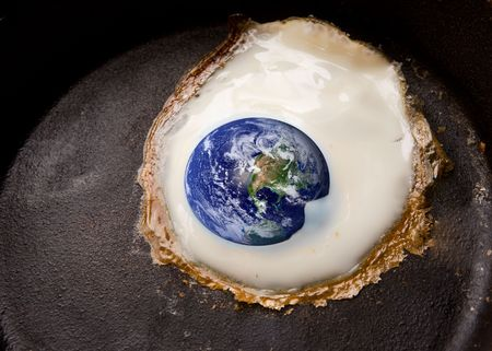 Global warming concept image with the world being fried in a frying pan like an egg. Stock Photo - 1894907