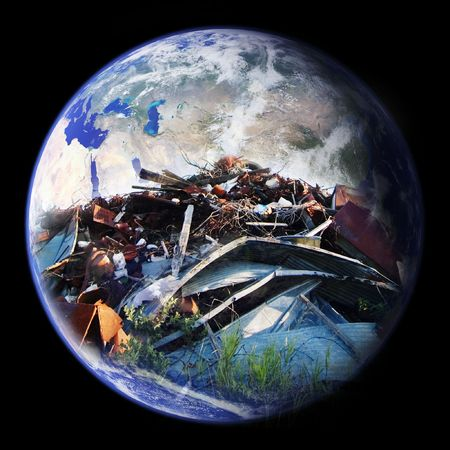 superimpose: A large pile of garbage double exposed on the planet earth - eastern hemisphere
