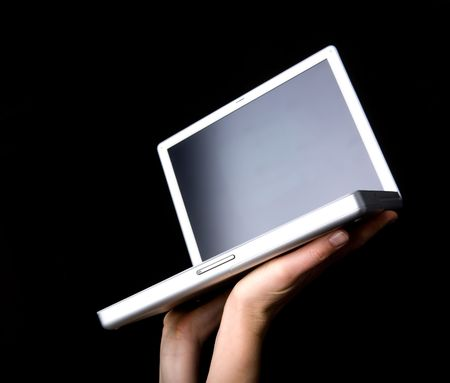 Laptop with blank screen - presented with a pair of hands photo