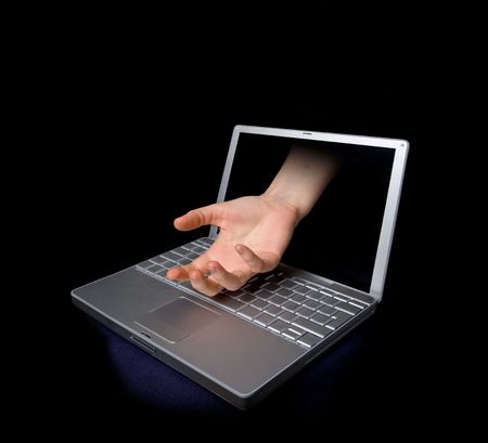 An open hand coming through a computer screen. Stock Photo - 2071621