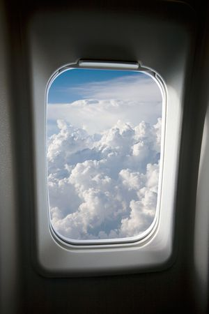 airplane window: A view of clouds from an airplane window.