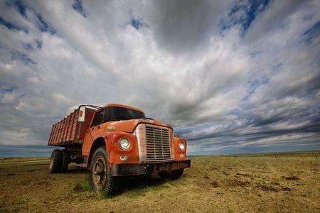 An old farm truck against a dramatic prairie landscape Stock Photo - 2348668