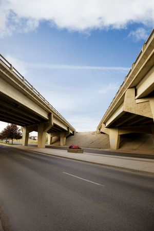 A crossing of two highways with a concrete overpass