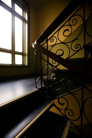stair well: A staircase with a art nouveaux banister