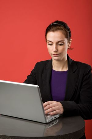 A young woman working on a latptop computer Stock Photo - 2346289