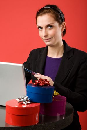 A young female shopping for christmas presents online photo