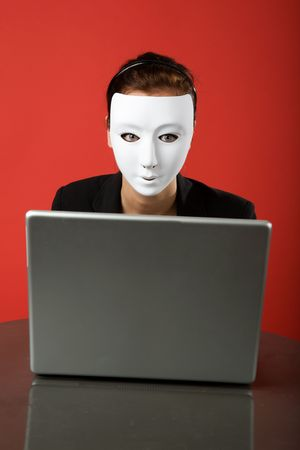 web scam: A female surfing the web anonymously