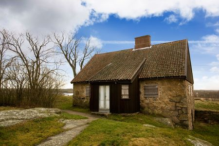 fredrikstad: An old stone house on a big landscape Stock Photo