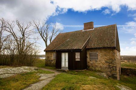 fredrikstad: An old stone house on a big landscape Stock Photo