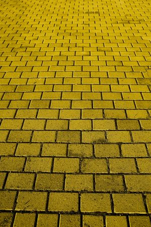 A background texture of a yellow brick road photo