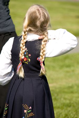 A young norwegian girl in a traditional costume