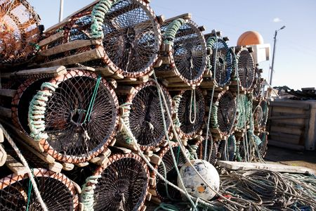 crab pots: A detail of lobster traps stacked on the dock
