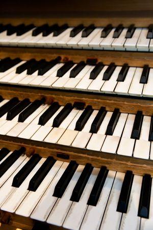 pipe organ: An old pipe organ keyboard in a church Stock Photo