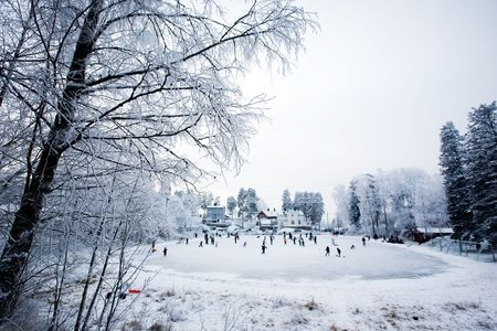 A group of people skating on a local rink Stock Photo