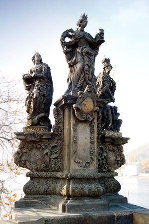 Statue detail on the Charles Bridge, Prague, Czech Republic. photo