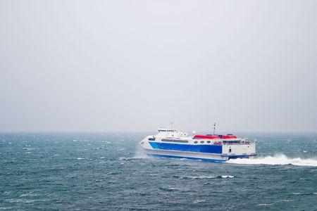 seabus: A speed ferry catamaran on the Ocean Stock Photo