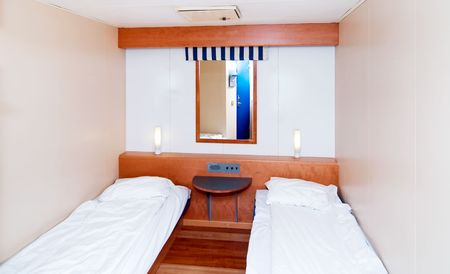A very small cabin room on a cruise ship photo