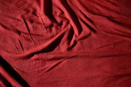 A red cloth texture with strong contrast and lines photo