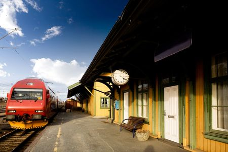 railway history: An old train station against a deep blue sky Stock Photo