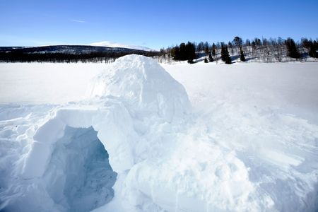 igloo: An igloo on a frozen lake in the mountains