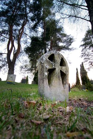 christian halloween: An old weathered gravestone from the 1800s