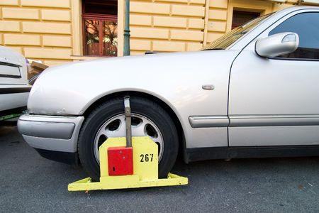 parking ticket: A wheel block parking ticket in Prague, Czech Republic.