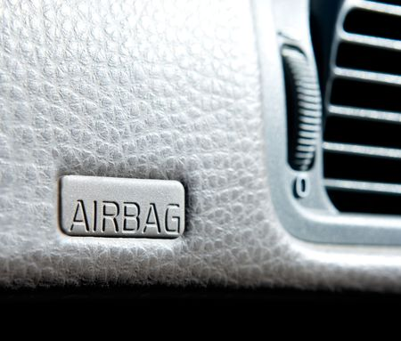 An airbag sign in a car on the dash Stock Photo - 2948054