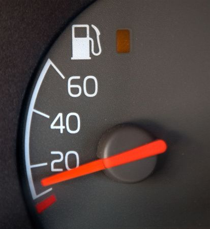 nearly: Gas Gauge showing nearly empty Stock Photo