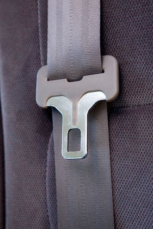 undone: A seatbelt in a car with cloth seats Stock Photo