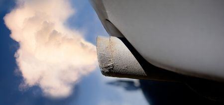 tailpipe: A car tail pipe with exhaust coming out