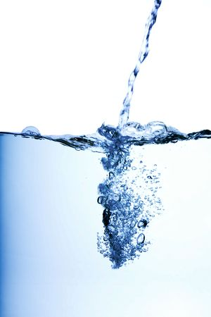 carbonation: Water flowing into a pool with side view