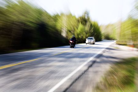 A motion blur image of a speeding car photo
