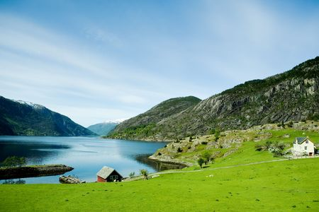 fjord: A fjord and rural norway with a blue sky Stock Photo