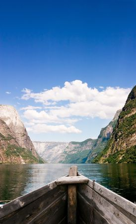 row: An old boat on a majestic norwegian fjord
