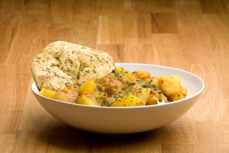 indian meal: An Indian meal - Potato curry with Lentis and Naan bread
