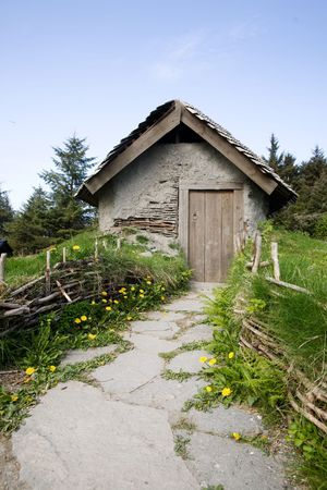 path cottage garden: A small hermit cottage like building