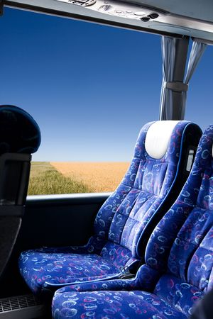 A prairie view from a bus photo