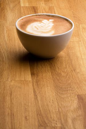 capucinno: A cappuccino with latte art on a wooden table Stock Photo