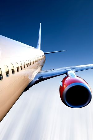 An airplane in flight over a blue sky photo
