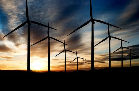 Wind power landscape at sunset on a flat horizon photo